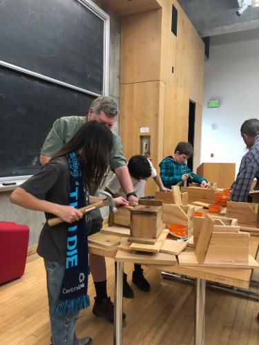 students learning woodworking