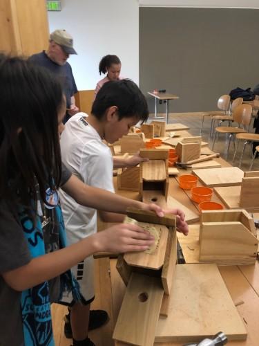 students building birdhouses