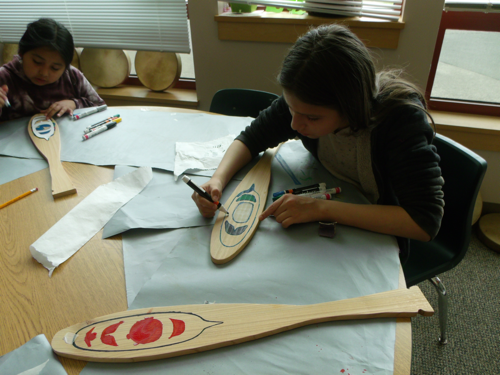 coloring a design on a paddle