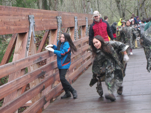 students and adults on bridge