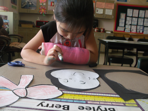 Student working on Seuss cat art project