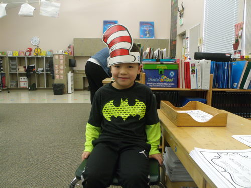 student showing his cat in the hat hat