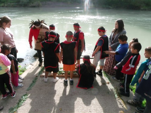 students at the water