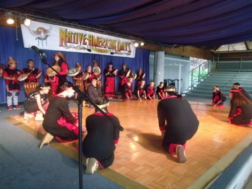 students kneeling during dance