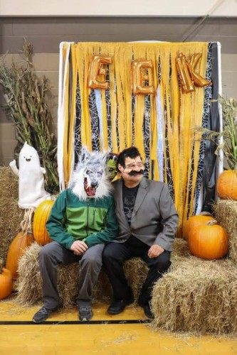 teachers in costumes at harvest festival