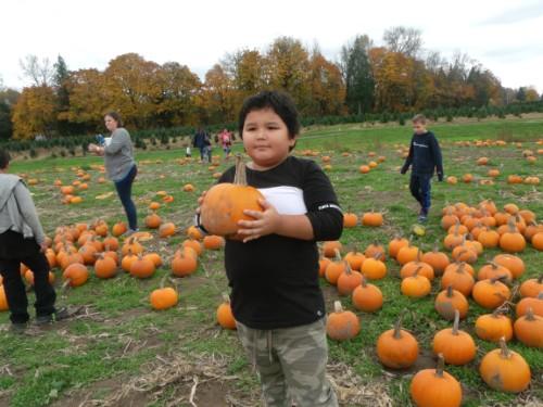 3rd grader and his pumpkin.