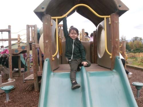 Kindergartner preparing to slide