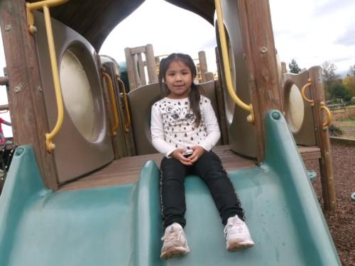 Kindergartner going down the slide