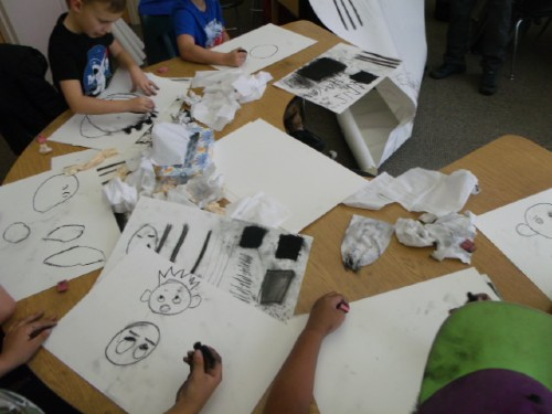 students creating pictures of faces