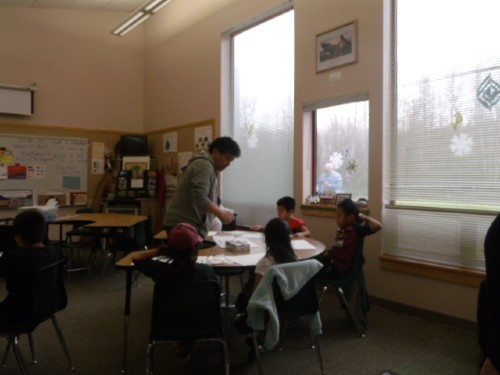 artist working with students